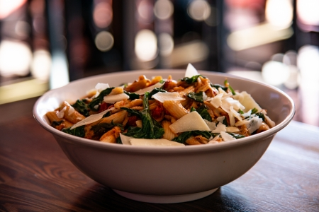 A big bowl of pasta with fresh spinach, big chunks of Parmesan cheese and freshly made pasta sauce