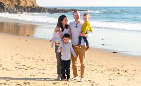 Family poses for Laguna Beach family photographer Jezrel White